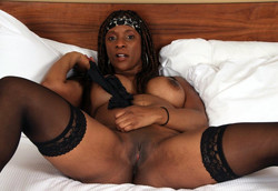 African MILF April rubbing her smooth..
