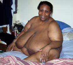 45 yo plump black mom squeezing her fat