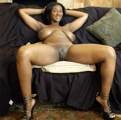 Nude, shaved ebony and black slits