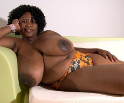 Cute ebony BBW MILF playing with her..