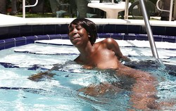 Perky, slim black girl posing for his..