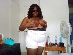 Thick black granny in huge white shorts